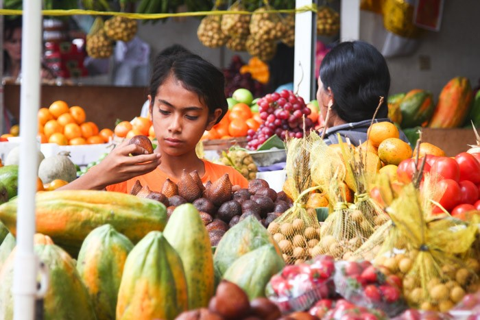 Woman inspecting fruit in Seminyak Market