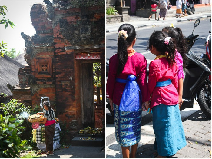 Temple in Seminyak and three Balinese girls waiting to cross the street